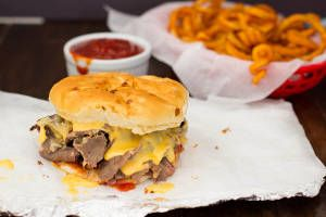 This Copycat Arby's Beef and Cheddar recipe is the ultimate fast-food copycat recipe. Thinly sliced roast beef is layered with cheese on a bun with an Arby's copycat sauce recipe.