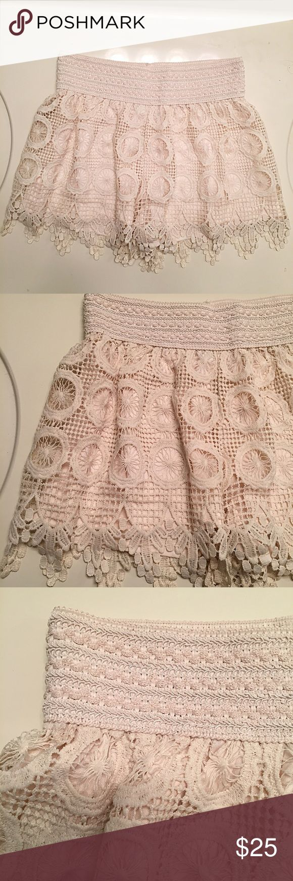 NEW cream lace shorts size Medium Brand new, never worn and still with tags. Unique intricate lace shorts with wheel-like patterns. Elastic waist line for a nice fit. Women's size Medium. Stellaluce Shorts