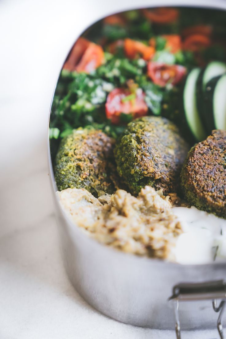Get the recipe for homemade falafel on Faring Well! Along with all the fixings to build your Mediterranean lunch box: tzatziki, tabbouleh, and baba ganoush!