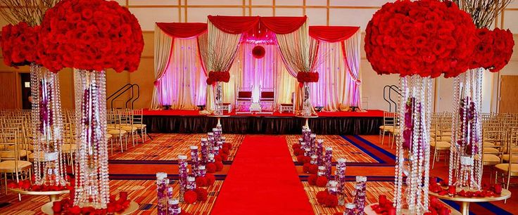 Red colored wedding stage with roses indicates pure love.. #bookeventz #weddingstage #stage #decor #decoration