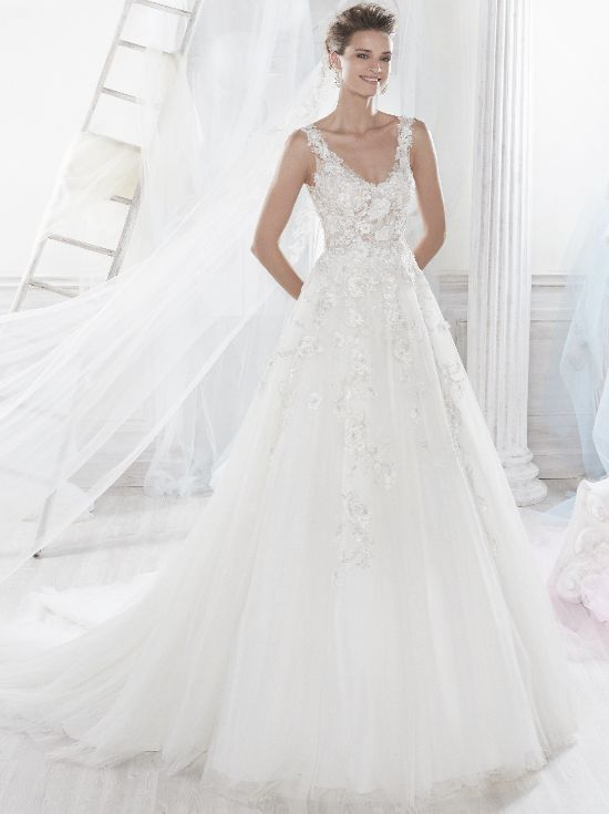 Intricate floral appliques adorn the bodice of this dress and they continue down into the skirt. The straps offer added support and the A-line shape flatters almost any body type. #WeddingDresses #Wedding #fashion