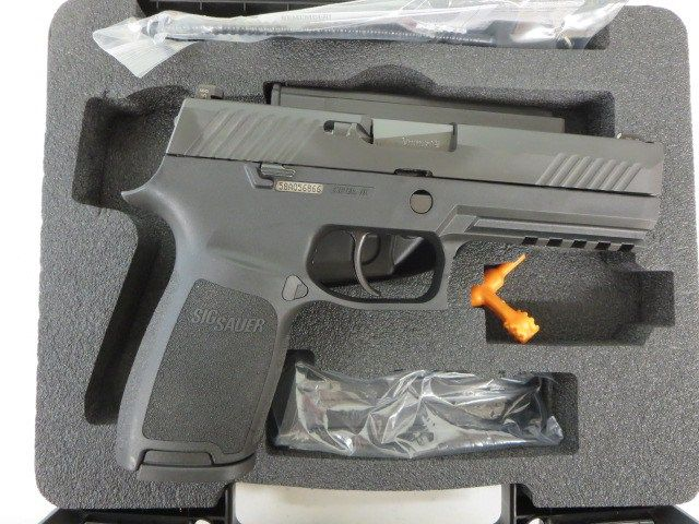 Used Sig Sauer P320 Full Size 9mm w/ night sights, extra magazine, holster and case $495 - http://www.gungrove.com/used-sig-sauer-p320-full-size-9mm-w-night-sights-extra-magazine-holster-and-case-495/