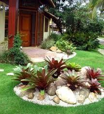 Resultado de imagem para como se faz canteiro com pedras no jardim