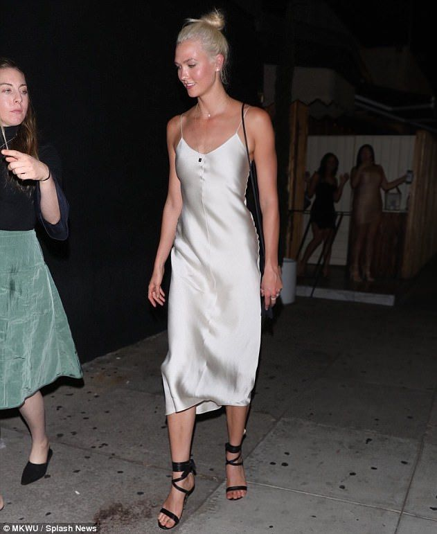 Striking looks: Karlie Kloss made a stylish exit from The Nice Guy restaurant in West Holl...