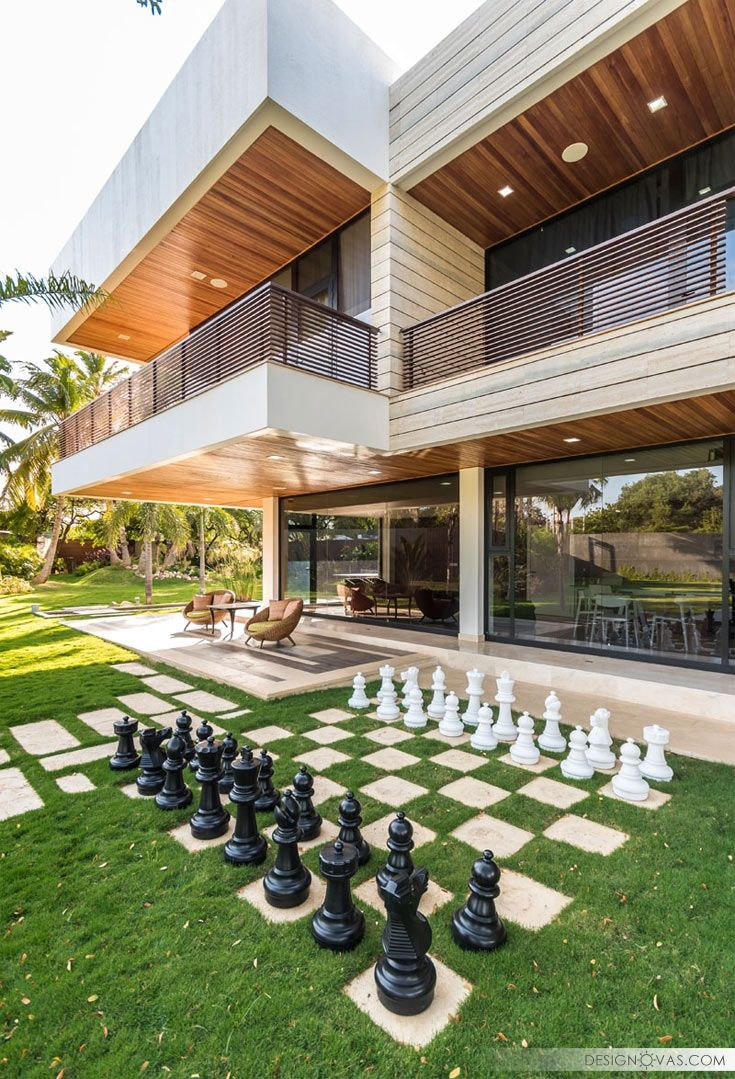 First up is this home that has a chess set built into the landscaped yard. It's just off the main living area of the home and a small covered patio lets people have a place to watch the game being played. House designed by Ferrer & Zraid Arquitectos. Photography by Luis Ontiveros. Source: http://www.contemporist.com Pinterest Facebook Twitter …