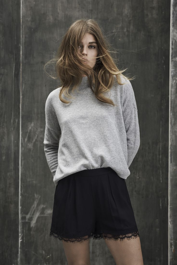 Grey knit with a high neck.