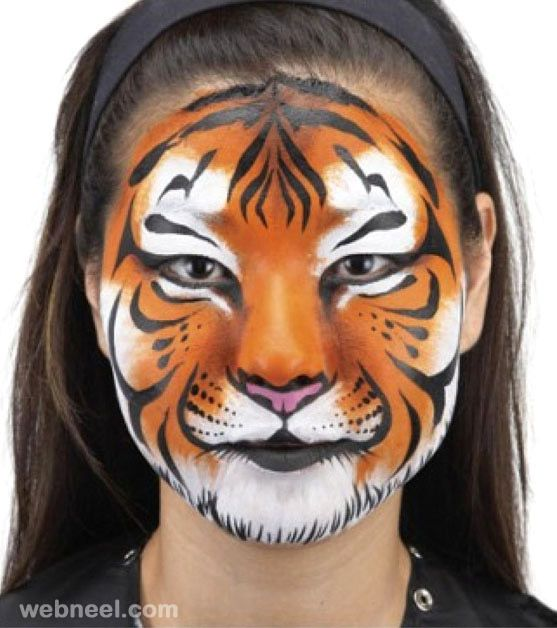 tiger face painting. Read Full article: http://webneel.com/face-painting-ideas | more http://webneel.com/daily . Follow us www.pinterest.com/webneel