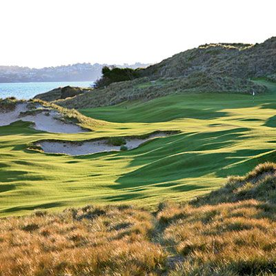 """Barnbougle Dunes    TASMANIA, AUSTRALIA    Like much of this largely eco-protected island, the young yet famous golf course laid out here is crisscrossed by heaving land features, their edges softened by a prevailing wind called the """"roaring forties."""" Seaside golf traditionally includes one compact hole that tests nothing but a player's educated hands and refined """"touch""""—at Barnbougle the diminutive par-3 seventh plays that role."""