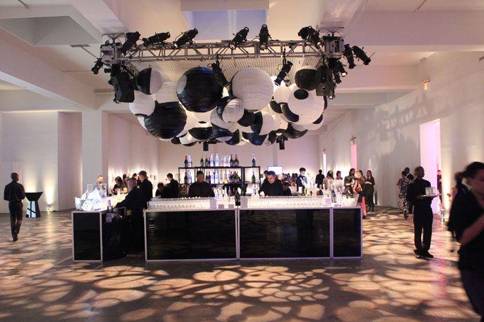 Use black and white lanterns to create a bubble canopy feature over a central, modern bar.