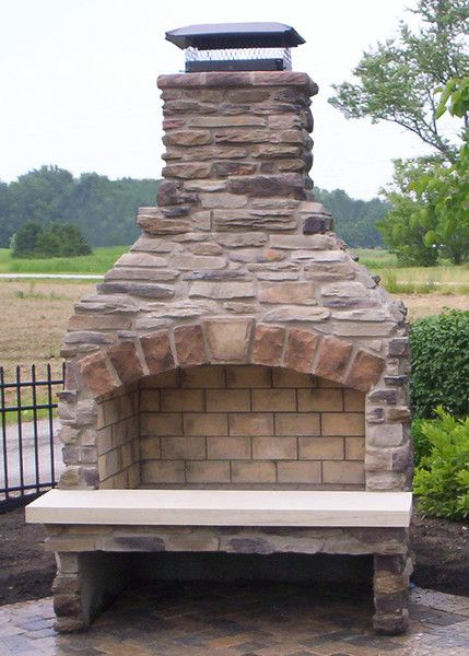 "36"" Standard Series Outdoor Fireplace Kit with cultured stone hearth."