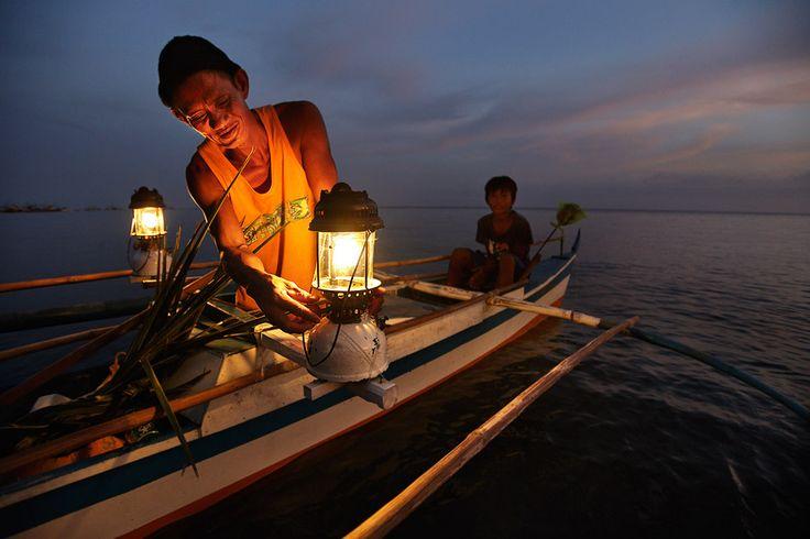 Fisherman with Petromax kerosine lamp.