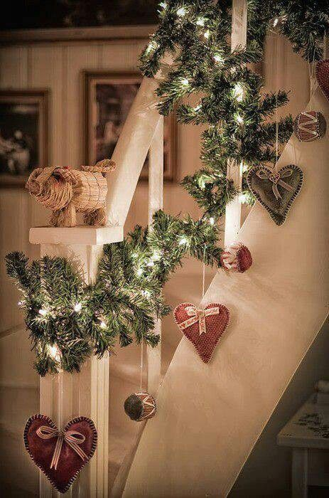 I love the garland idea going up the staircase, although I wouldn't use hearts and the wrapping of the railings would be a tad more organized.
