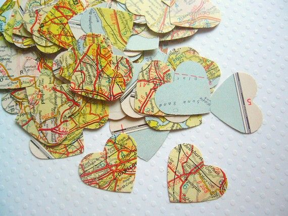 Shapes cut from old atlases or maps... what a FANTASTIC idea. You could change both the shape and the design too - what about using old newspaper, or second-hand piano books?