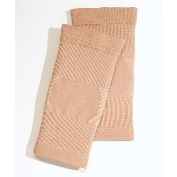 The first gel knee pad designed specifically for dancers! Constructed of a soft but sturdy bamboo knot fabric, contoured silicone knee pads provide maximum pressure relief without the bulk of common knee pads. Nude fabric and low profile make them less visible on stage. Slips on and stays in place. Won't roll in the back of the knee. Available in two sizes. Two knee pads per package.