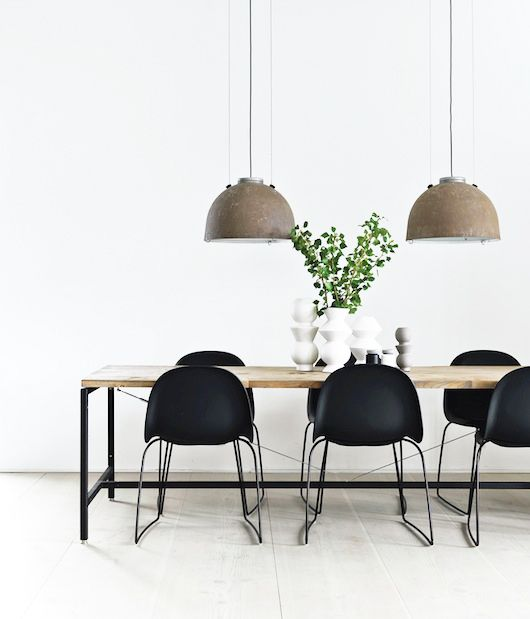 Home of vipp's chief designer with two 'Københavner' lamps hanging above the dining room table