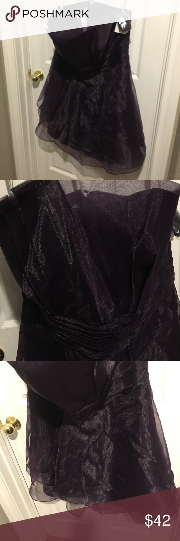 NWT David's Bridal Strapless Organza Dress Lapis NWT David's Bridal Strapless Organza dress in Lapis Size 18 . Ruffles in front of skirt  , ruched waist . Fully lined . Zips up the back . No flaws, stains, tears or defects. Comes with bag with strap in case you want to wear it as a halter if you need more support 👌🌷Gorgeous David's Bridal Dresses Strapless
