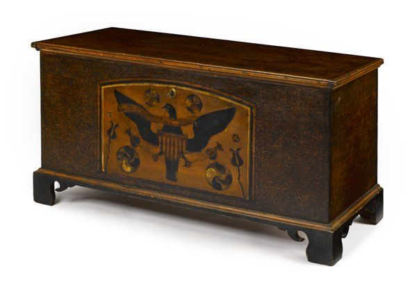 Sold $4,000  Centre County, Pennsylvania painted pine dower chest, dated 1814, the front with a large panel of a spread winged eagle and tulips surrounded by an ochre sponge ground with pinwheels, 27 1/4'' h., 50'' w. A chest painted by the same hand is illustrated in Fabian, The Pennsylvania German Decorated Chest, plate 163.