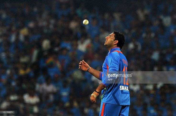 Indian bowler Yuvraj Singh tosses the ball in the air prior to bowling a delivery during the second T20 match between India and New Zealand at the M.A. Chidambaram Stadium, in Chennai on September 11, 2012. AFP PHOTO / Manjunath KIRAN