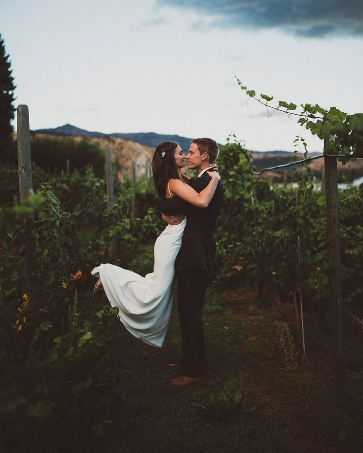the rain stopped just in time for Taylor and Lindsay to walk around the vineyards as newlyweds. -