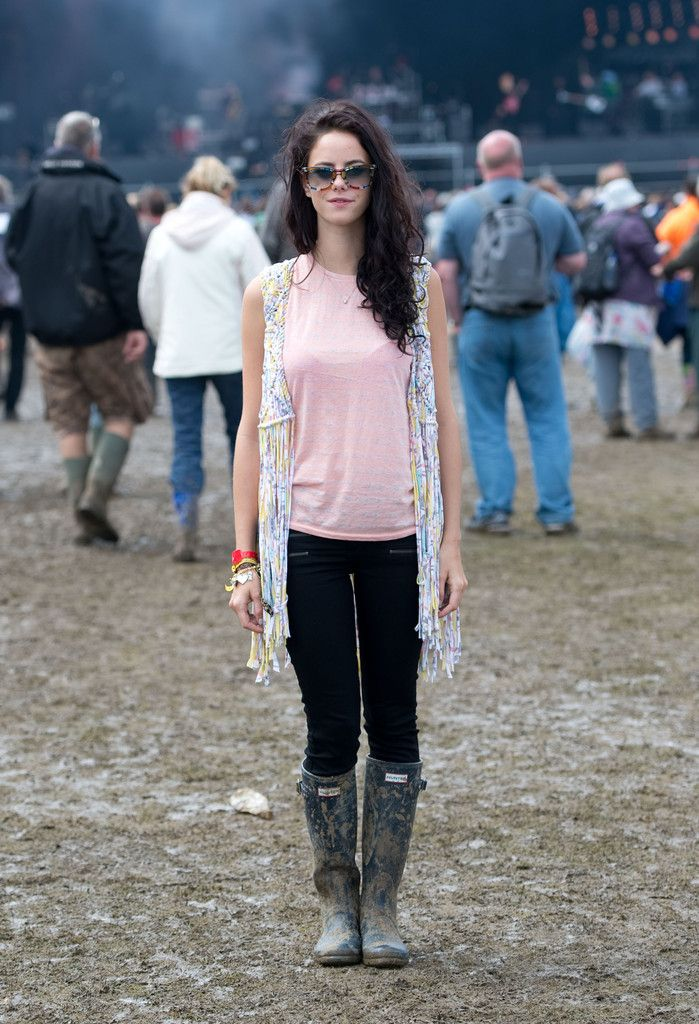 Kaya Scodelario posese on the main stage on day 4 of The Isle of Wight Festival at Seaclose Park on June 24, 2012 in Newport, Isle of Wight.