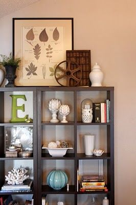Display shelf with lots of clean, crisp decor.