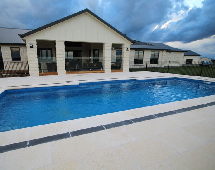 Macrostone International. Stone: Madagascar  Madagascar Stone has a lovely warm white to yellow glow, perfect for around the pool in all kinds of weather.