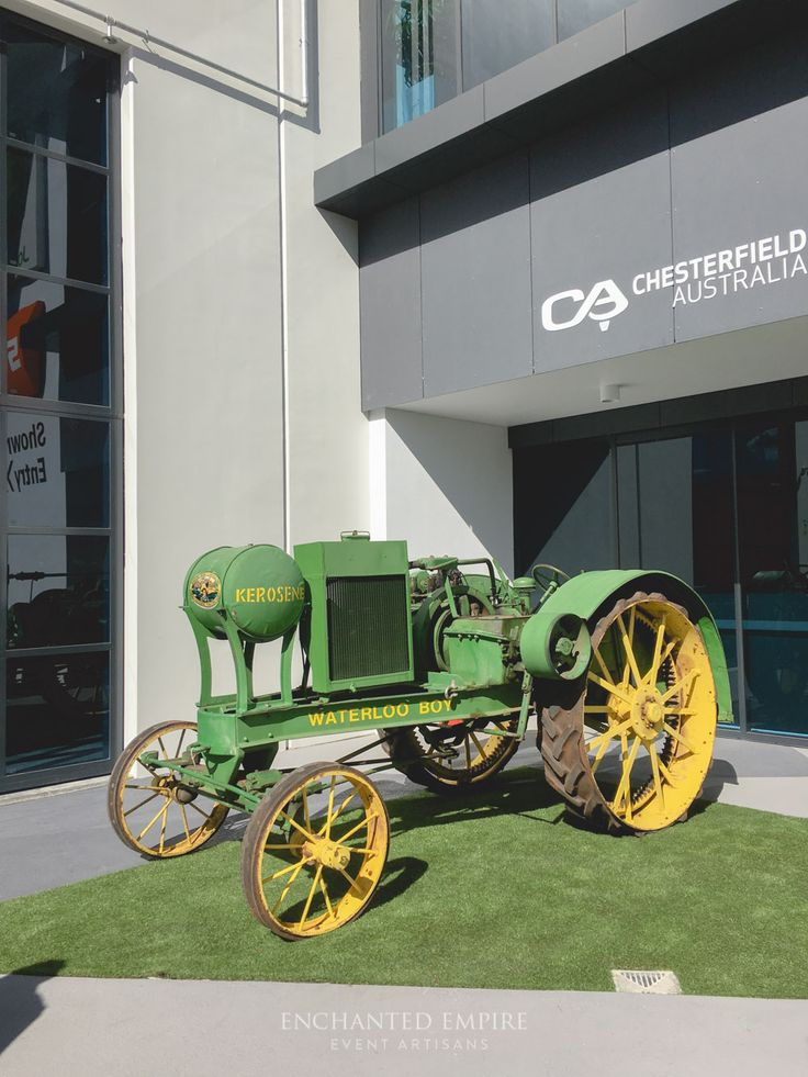 Playing on the bold green and yellow colour palette, our client wanted to really emphasise the Australiana feel whilst keeping it quite formal and elegant. Built up with Willow Pintuck dry bars with pops of yellow Tolix Stools to tie in with the John Deere branded oil drums, also used as dry bars. Each table adorned with champagne crushed taffeta tablecloths, thin gold-rimmed glass charger plates, willow napkins and gorgeous Mahogany Tiffany Chairs. Corporate promotional event.