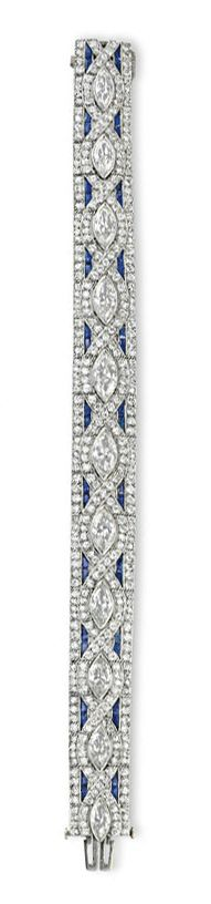 AN ART DECO DIAMOND AND SAPPHIRE BRACELET   Designed as an articulated circular-cut diamond band of geometric motif, centering upon a series of marquise-cut diamonds, accented by calibré-cut sapphire detail, mounted in white gold, circa 1925, 7 ins.