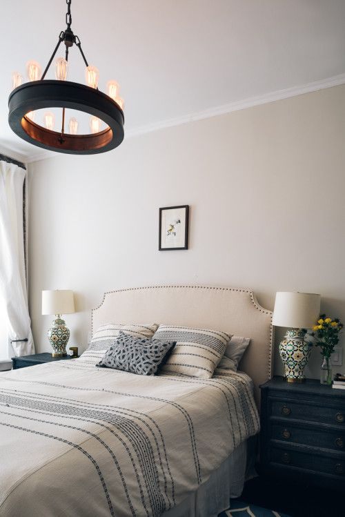 this simple linen headboard from Crate & Barrel. We also added the dark indigo nightstands to the bedroom to make the whites in the room rea...
