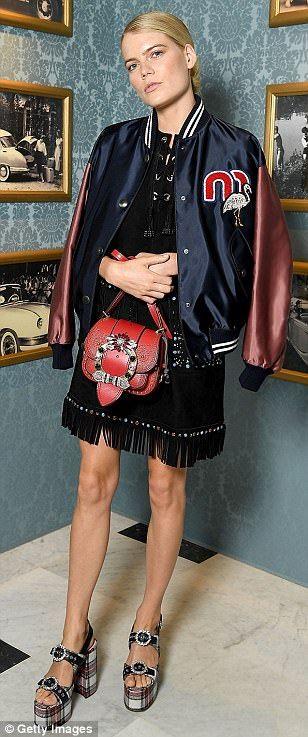 Shameless star Emma Greenwell went for a varsity style     Read more: http://www.dailymail.co.uk/tvshowbiz/article-4661268/Kendall-Jenner-Bella-Hadid-Jourdan-Dunn-storm-runway.html#ixzz4lmmSco5Z   Follow us: @MailOnline on Twitter | DailyMail on FacebookKendall Jenner and Bella Hadid storm Miu Miu AW17 runway | Daily Mail Online