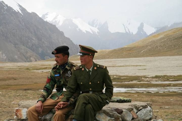 We've come to expect images of fear and hostility from the world's borders, but this photograph of two border guards - one from China the other from Pakistan shows a heartwarming display of camaraderie.