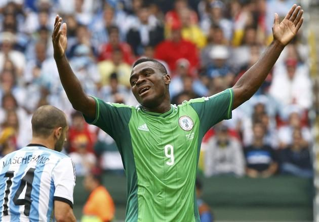 soccer world cup groups 2014 | Nigeria's Emenike gestures during the 2014 World Cup Group F soccer ...
