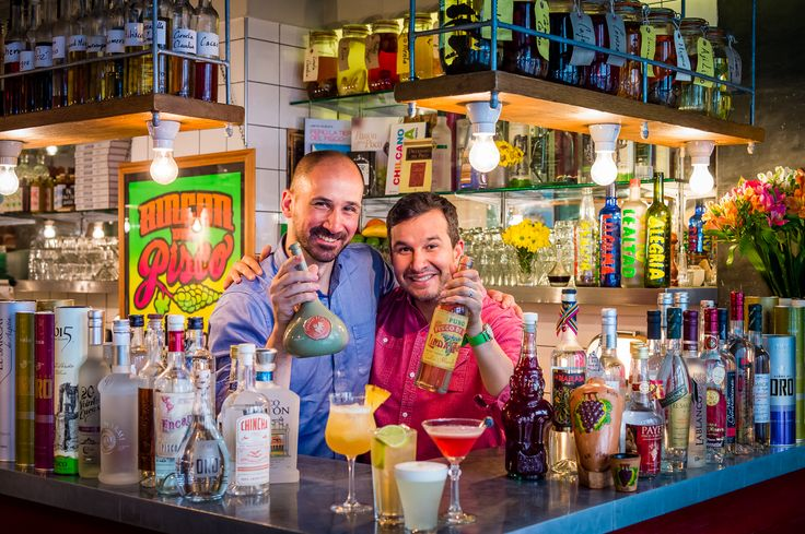 Martin and Miguel with one of the world's oldest pisco bottles and with the most expensive artesian pisco (100 bottles)