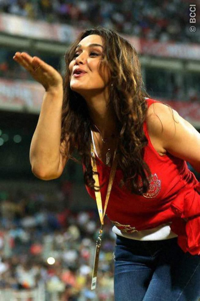Preity Zinta blowing a kiss to her fans during an #IPL 2015 match. #Bollywood #Fashion #Style #Beauty