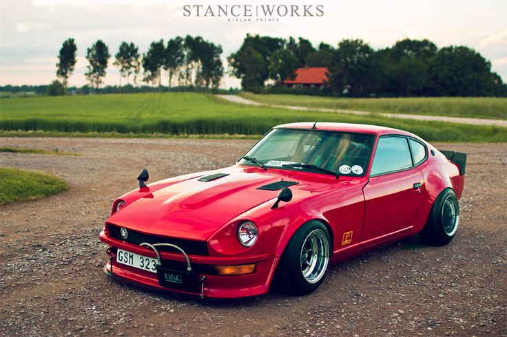 ERIK JONASSON'S DATSUN 240Z.   I like American Muscle more than import, but this is pretty slick looking.  Stretched tires, slammed and I'm sure it's got an aggressive tune.