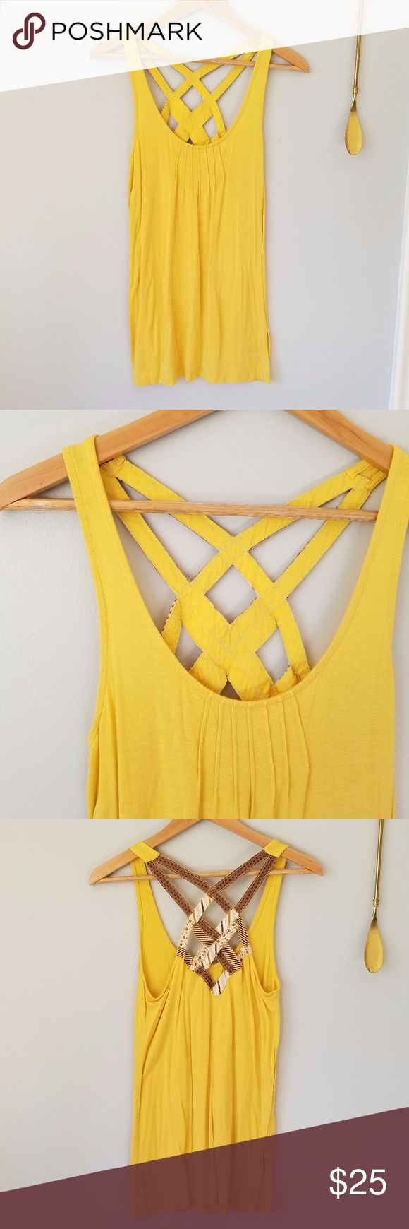 """Urban Outfitters Yellow Tank w/ Criss Cross Straps Urban Outfitters Yellow Tank w/ Criss Cross Straps//kimchi & blue//The straps on the back have fun brown patterned fabric overlaying the yellow fabric//There are pleats on the bust to make it more flattering//Fabric is very stretchy so can be worn tight or loose//Bust: 18"""", Length: 25.5""""//Materials: 95% rayon, 5% spandex//Size: US Women's Medium//Worn once Urban Outfitters Tops Tank Tops"""