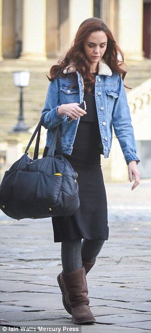 Keeping things casual: Jenniferdressed down and kept warm in the chilly temperatures in a smart black dress layered under a denim jacket
