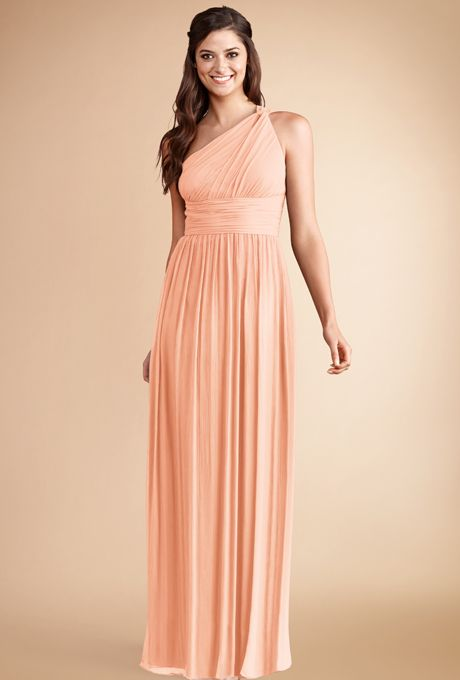 "Brides.com: . ""Rachel"" poly-chiffon one-shoulder bridesmaid dress in peach fuzz, $230, Donna Morgan"
