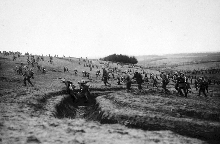 German troops cross a field, ca. 1918. During 1918 the nature of the War changed drastically when the German army launched it's Spring offensive called the Kaiserschlact (Kaiser's Battle). Tactical and mechanical advances over the last few years paid...