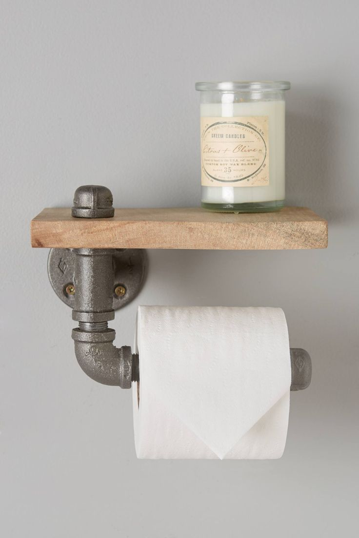 "Reclaimed Sycamore Toilet Paper Holder - $78 anthropologie.com, hard-carved sycamore wood, steel pipe, 4""H, 7.5""W, 5""D"