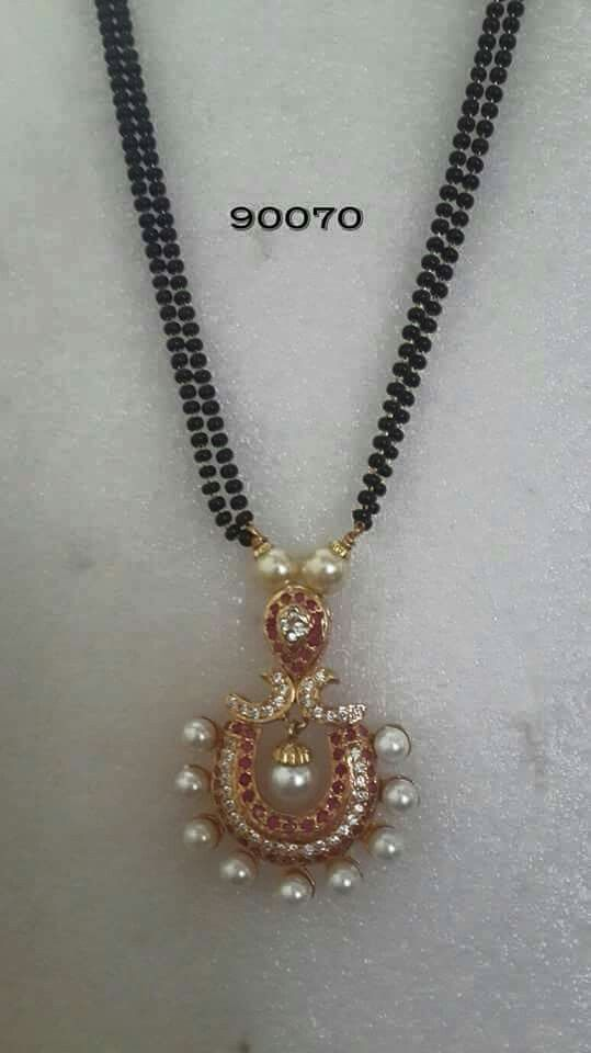 Black beads with ruby and white stones pendant