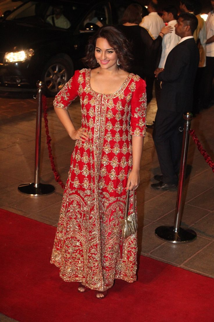 ANUSHKIA SINHA in a red dress at Arpita Khan's wedding