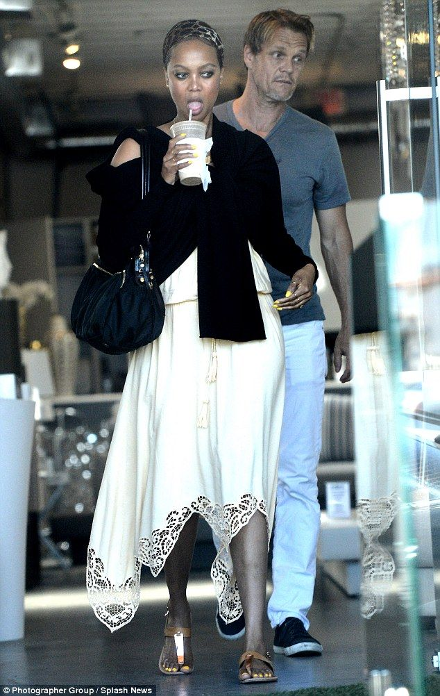 Still going strong: Tyra Banks and boyfriend Erik Asla were spotted shopping in LA on Monday
