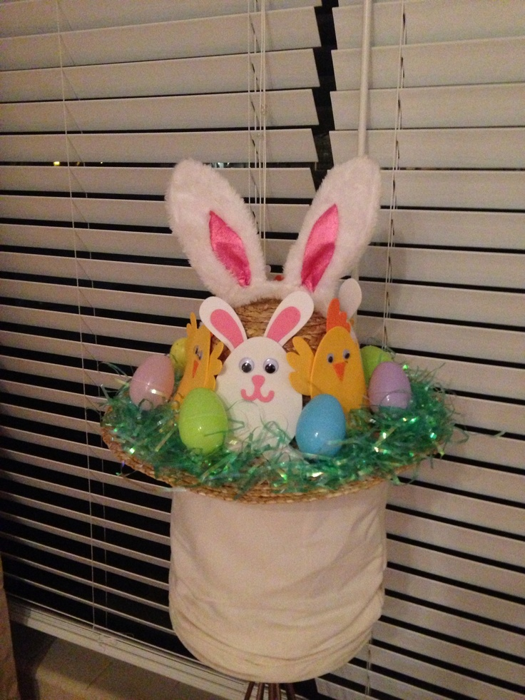 Easter hat for kids Easter hat parade. Straw hat from Michael's, plastic eggs, Easter grass, bunny ears and foam cut outs!! Super simple and super cute!! A great DIY project.