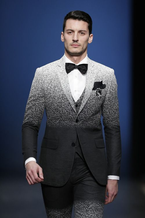 Ruben Rua in Miguel Vieira A/W '14.  Speckled ombre/gradient suit.