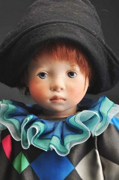 """Close up of 22"""" soft-bodied Harlequin doll, with bisque porcelain limbs, shoulder plate, and head, made in a limited edition of 12 pieces, Germany, 1990, by Sylvia Natterer."""