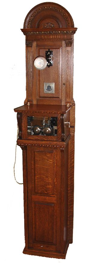 Model: 6' long distance cabinet phone   Made by: Western Electric Co.  From: circa 1890s  Courtesy of: Tom Adams  This is a very early Western Electric long distance wood wall phone. Early long distance phones had to be very big to hold all the batteries it would take to power a long distance conversation.