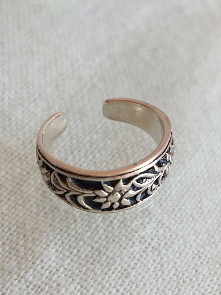 A personal favorite from my Etsy shop https://www.etsy.com/ca/listing/530933074/silver-toe-ring