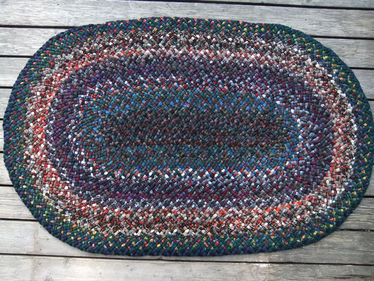 here's a whole bunch of tartan skirts braided into a rug.Braided by Val Galvin, Renditions in Rags.