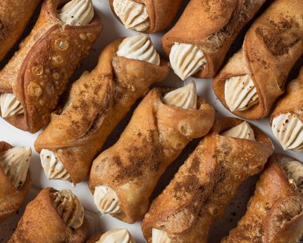 "Are you ready for a sweet history lesson? Cannoli originated in Sicily, where the word cannolo, or cannolu, means ""little tube"". Today, these little tubes full of deliciousness are a popular treat"